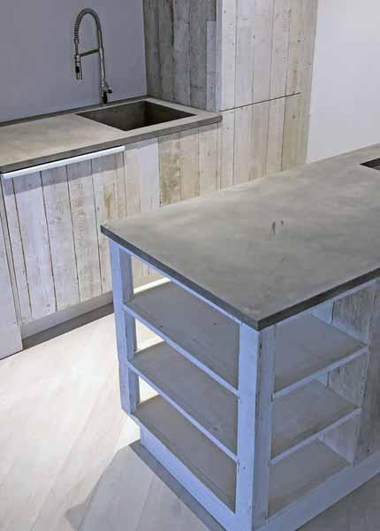 dettaglio isola cucina legno e cemento